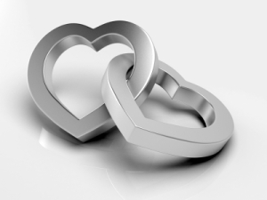 Silver hearts on white background