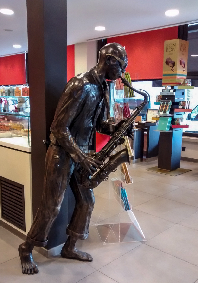 Dinant Belgium - Sax Player in chocolate shop